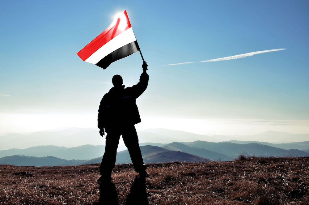 Yemen man with flag